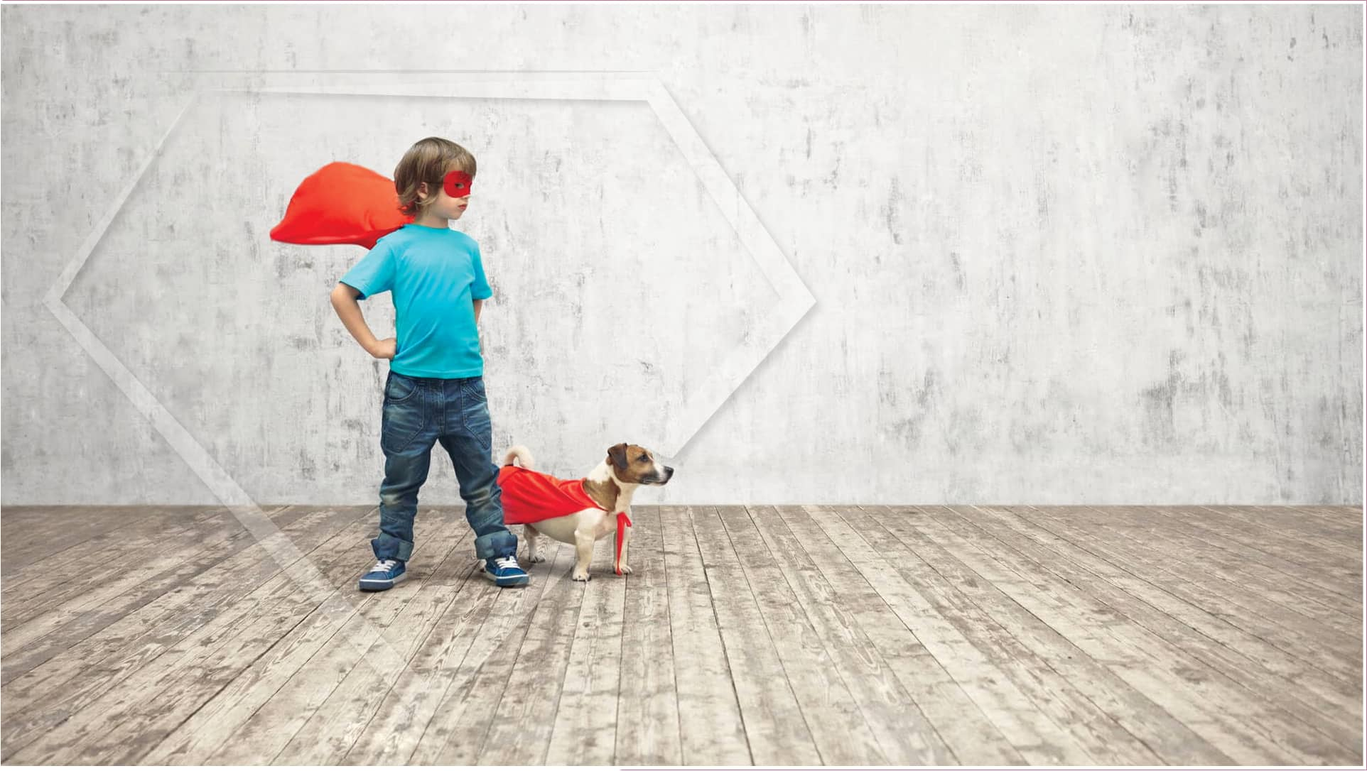 young boy and dog with capes